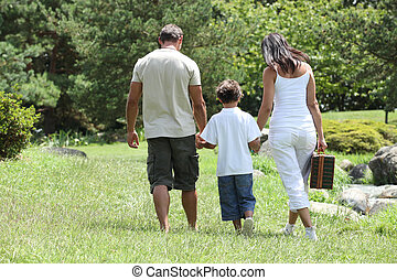 parents and their son in the park