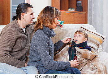 Parents caring for sick boy