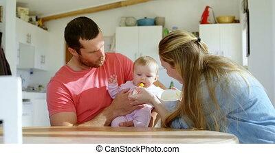 Parents feeding their baby boy 4k