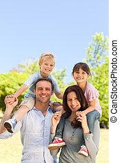Parents giving  children a piggybac