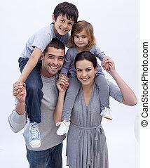 Parents giving children piggyback rides at home