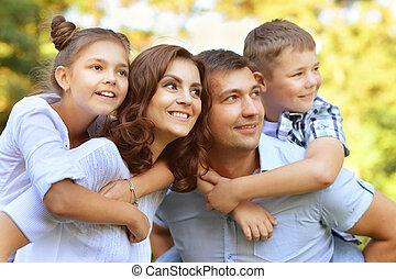 Parents Giving Children Piggybacks