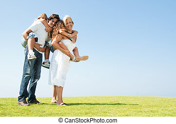Parents giving piggyback rides
