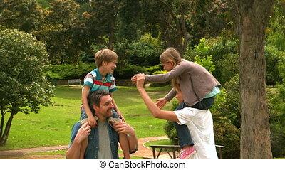 Parents giving their children pigg