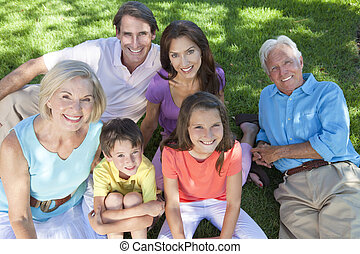 Parents Grandparents Children Family Relaxing Outside