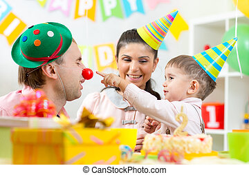 parents have fun celebrating birthday of his kid son