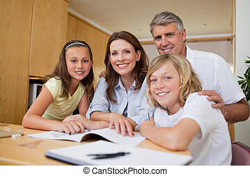 Parents helping their children with homework