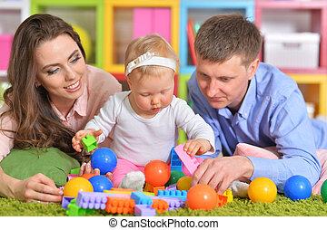 parents, heureux, fille, jouer, portrait
