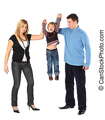 Parents hold son for hands, full body