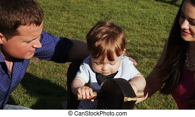 Parents kiss child outdoors