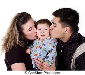 Parents kiss his son