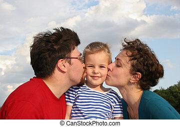 parents kiss son