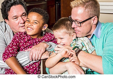 Gay parents kissing and hugging their children