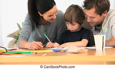 Parents looking at their lovely son drawing