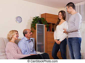 parents meeting girlfriend of their son at home in the everning