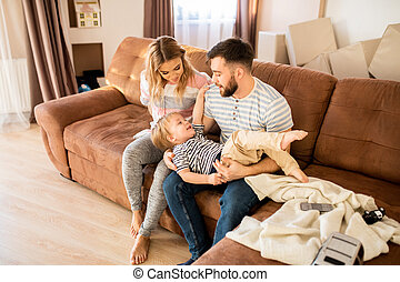 Parents Playing with Son at Home