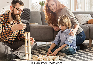 Parents playing with son