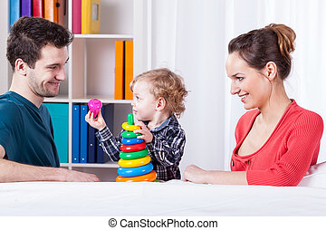 Parents playing with their child
