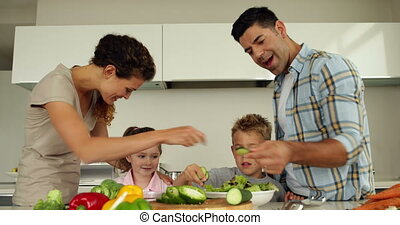 Parents preparing a salad with thei
