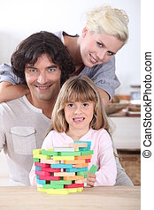 parents spending time with their little girl at home
