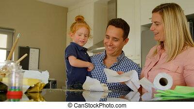 Parents teaching their son to clean kitchen worktop 4k - ...