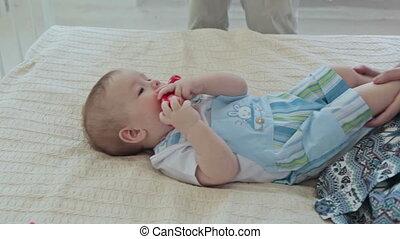 Parents tickle their son