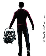parents walking rear view with baby silhouette