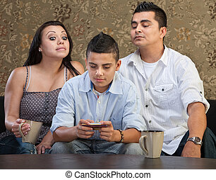 Parents Watching Teen Sending Messages