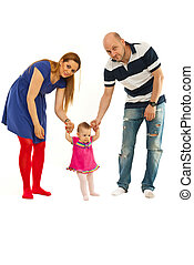 Parents with baby first steps