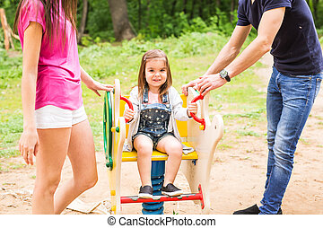 parents with baby girl in park