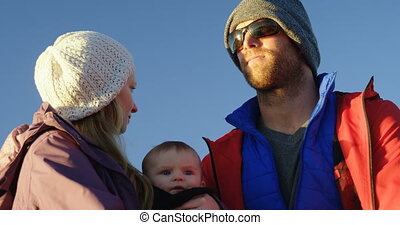 Parents with baby travelling in motorboat 4k - Close-up...