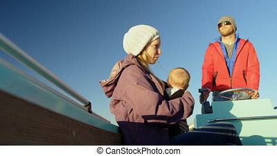 Parents with baby travelling in motorboat 4k - Parents with...