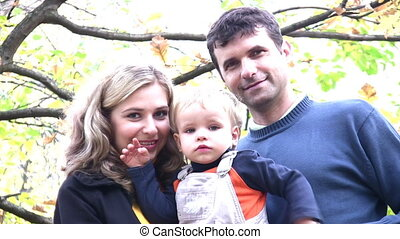 parents with boy in park. faces