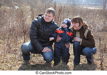 Parents with child outdoor in spring