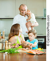 parents with children cooking  fish at home kitchen