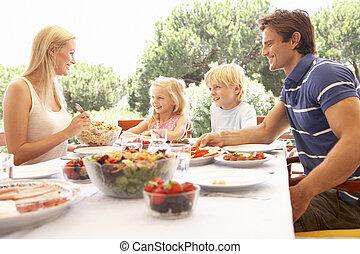 Parents, with children, enjoy a picnic