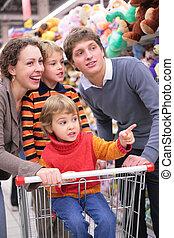 Parents with children in shop