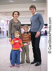 Parents with children in supermarket