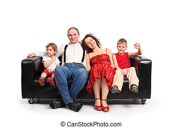 Parents with children sit on black leather sofa