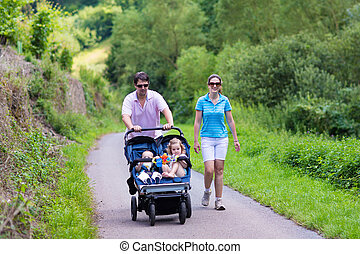 Parents with double stroller