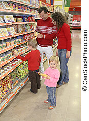 parents with son and daughter in shop