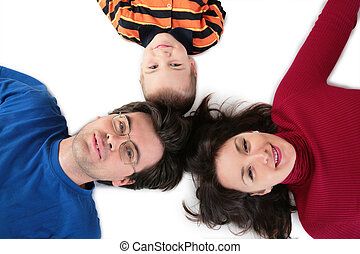 Parents with son lying top view