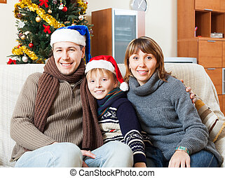 Parents with  son posing for  Christmas portrait