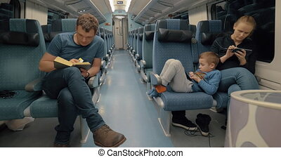 Parents with son traveling by express train
