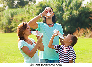 parents with teenager drinking water
