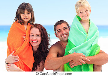 Parents with their children in towe