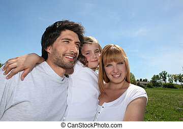 Parents with their daughter in a park