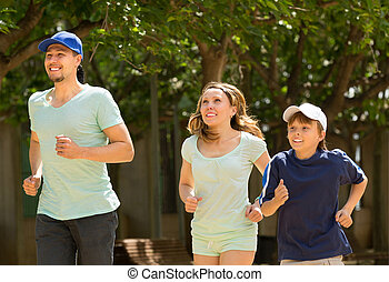 parents with their son  jogging in the park