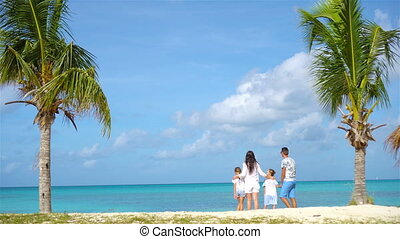 Parents with two kids enjoy their caribbean vacation on...