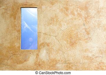 parete blu, buco, cielo